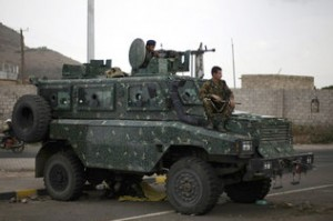 """Police in an armored vehicle secure a road leading to the U.S. embassy in Sanaa, Yemen, Tuesday, Aug. 6, 2013. The State Department on Tuesday ordered non-essential personnel at the U.S. Embassy in Yemen to leave the country. The department said in a travel warning that it had ordered the departure of non-emergency U.S. government personnel from Yemen """"due to the continued potential for terrorist attacks"""" and said U.S. citizens in Yemen should leave immediately because of an """"extremely high"""" security threat level. (AP Photo/Hani Mohammed) HANI MOHAMMED / AP Read more here: http://www.miamiherald.com/2013/08/07/3548486/yemen-turmoil-could-stall-obamas.html#storylink=cpy"""