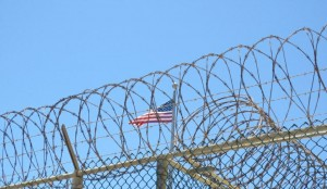 The American Flag waving in the wind outside of Guantanamo's prison camps. Photo taken by Jason Leopold at Guantanamo in May 2013.