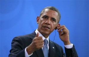 U.S. President Obama addresses news conference at Chancellery in Berlin