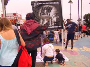 Hunger-strike-outreach-Venice-Beach-072813-by-Keith-James